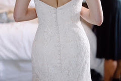 Danielle Caprese 'Sweetheart Mermaid' size 4 used wedding dress back view on bride