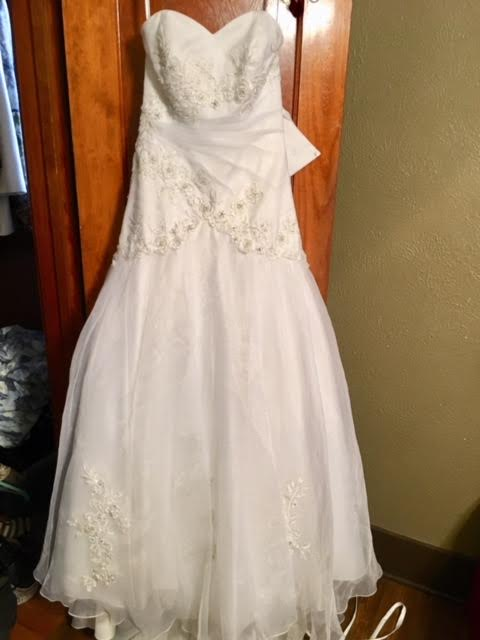 David's Bridal 'Beaded' size 0 used wedding dress front view on hanger