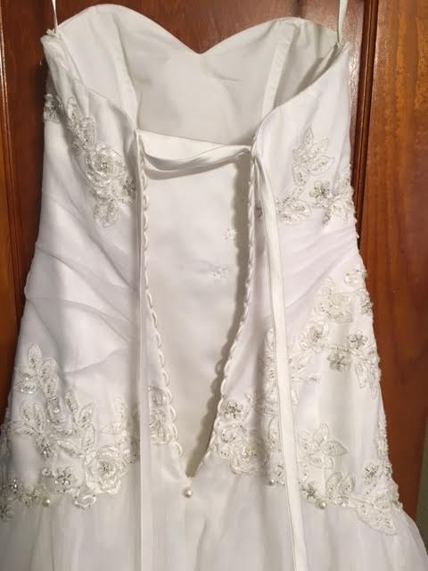 David's Bridal 'Beaded' size 0 used wedding dress back view on hanger