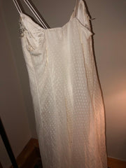 Carolina Herrera 'Chiffon' size 12 used wedding dress back view on hanger