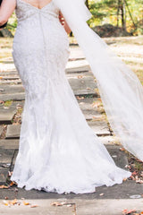 Justin Alexander 'Jazbride' size 18 used wedding dress back view on bride