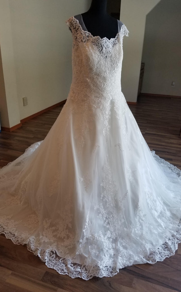Maggie Sottero 'Ballgown Princess' size 22 new wedding dress front view on mannequin