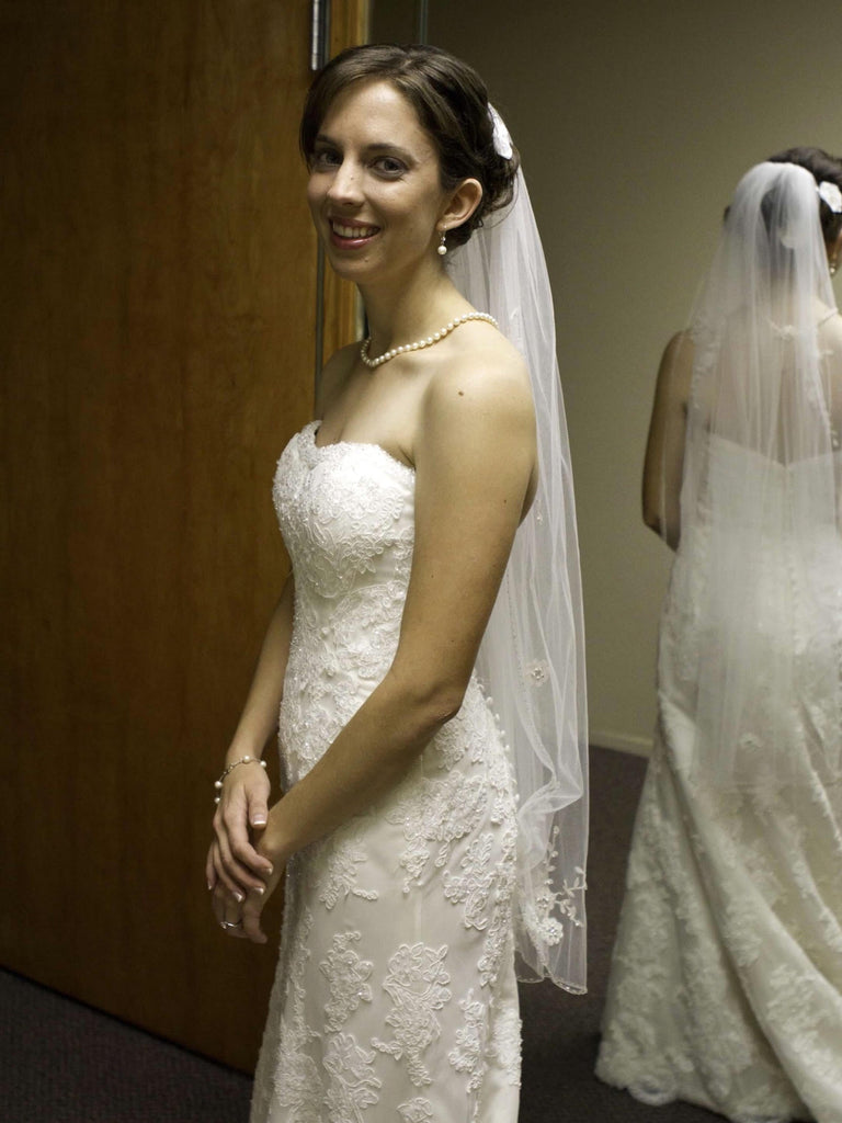 Demetrios 'Lace' size 4 used wedding dress side view on bride