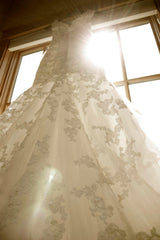 Casablanca 'Imperial' size 8 used wedding dress front view on hanger
