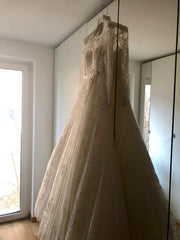 Elie Saab 'Birgit' size 6 used wedding dress side view on hanger