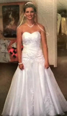 David's Bridal 'Beaded' size 0 used wedding dress front view on bride