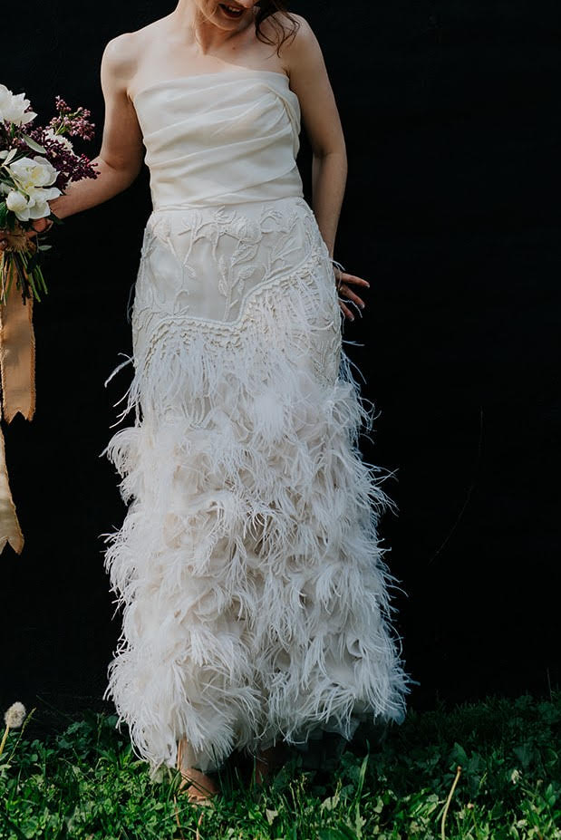 Marchesa 'Ostrich Feathered' size 4 used wedding dress front view on bride
