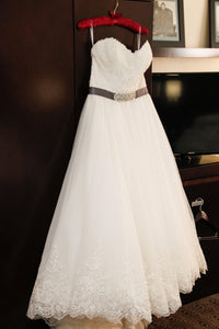 Custom 'Princess' size 16 used wedding dress front view on hanger