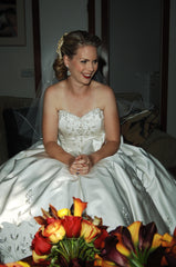 Custom 'Strapless Beaded' size 4 used wedding dress front view on bride sitting
