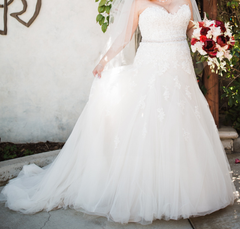 Sophia Tolli 'Prinia' size 18 used wedding dress front view on bride