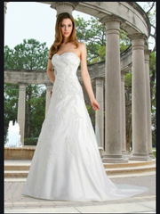 David's Bridal 'Strapless Pleated A-Line' size 4 used wedding dress front view on model