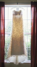 Load image into Gallery viewer, Paloma Blanca 'Strapless Ivory' size 4 used wedding dress front view on hanger