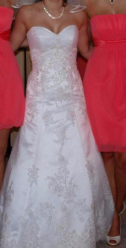 Maggie Sottero 'Straplesss' size 6 used wedding dress front view on bride