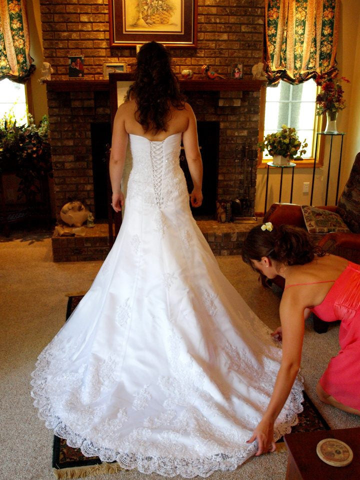 Maggie Sottero 'Straplesss' size 6 used wedding dress back view on bride