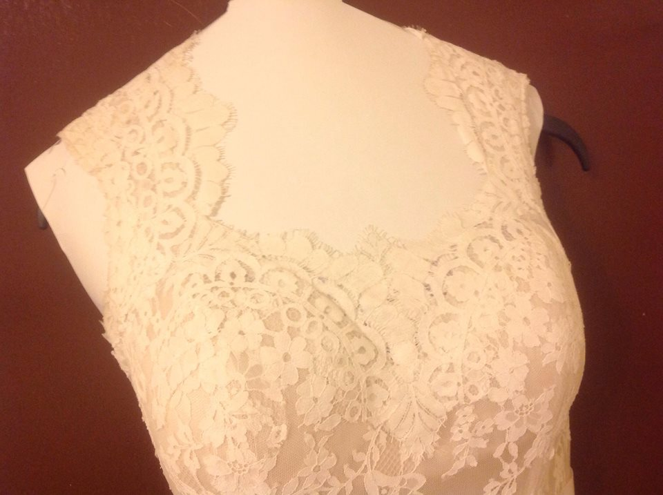 Maggie Sottero 'Londyn' size 4 used wedding dress front view on hanger