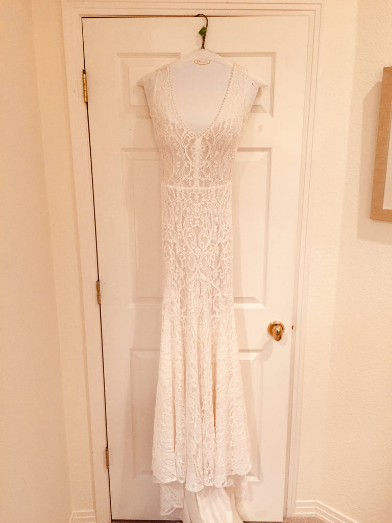 Daalarna 'Sensuous' size 2 used wedding dress front view on hanger