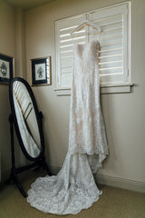 Ashley and Justin '10413' size 8 used wedding dress front view on hanger