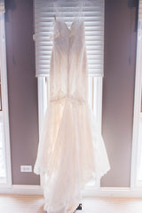Amy Kuschel 'Monroe' size 0 new wedding dress back view on hanger
