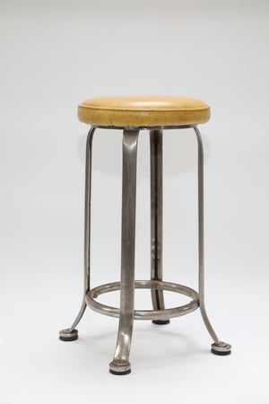 Wonderwall Retro Stool with brushed chrome legs and mustard vinyl cushion