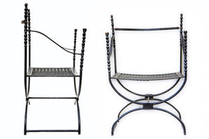Two Black Iron Chairs with Slopped Arm from Wonderwall Home Decor and Fine Furnishings