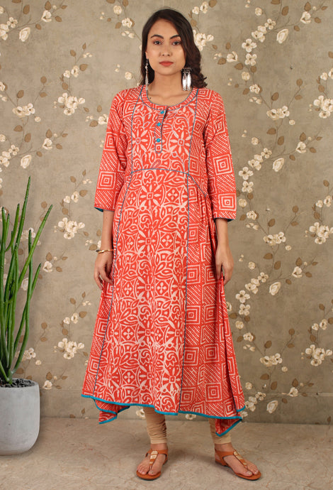 The Dabu Print Asymmetric Dress in Bright Orange