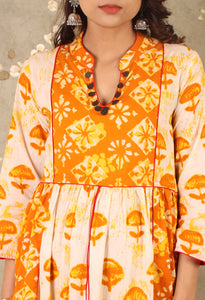Beige & Orange Printed Asymmetrical Kurti