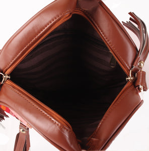 Textured round sling bag