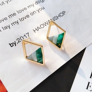 Contracted lozenge color contrast color earrings female fashion lady geometric hollow out the triangle stud earrings earrings