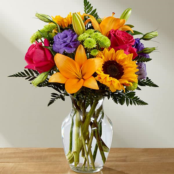 BEAUTIFUL FRESH ROSES, LILIES AND SUNFLOWERS ARRENGEMENT