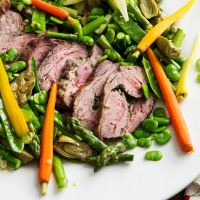 colorful platter of roasted lamb and spring vegetables