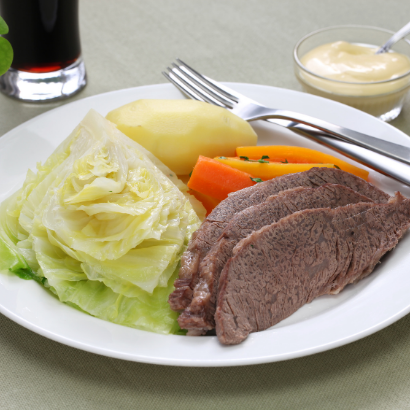 slow cooked beef with cabbage carrots and potatoes