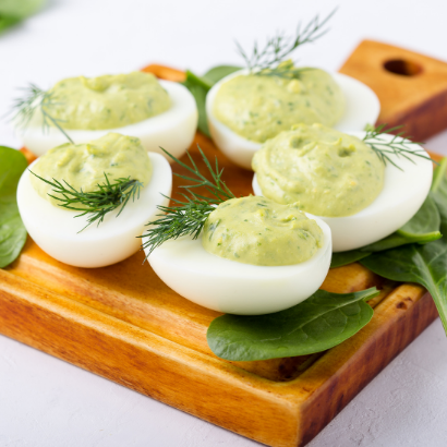 green deviled eggs made with avocado