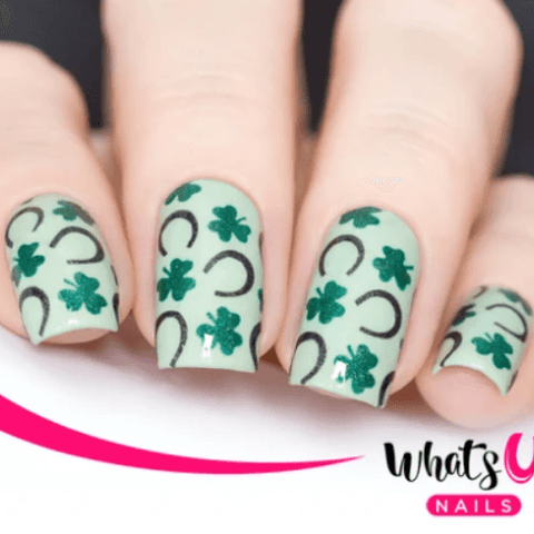 green clovers and black horseshoes on white nail polish