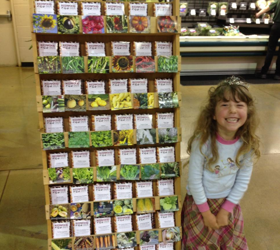 The seed princess and our new rack at the Holiday Market in Weaverville. CA!