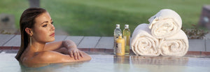 Guest enjoying the hot tub featuring Spa Products from The Lodge at Torrey Pines