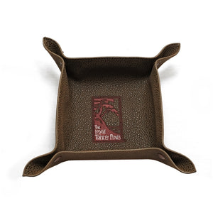 Top view of brown valet tray in faux suede with The Lodge at Torrey Pines logo