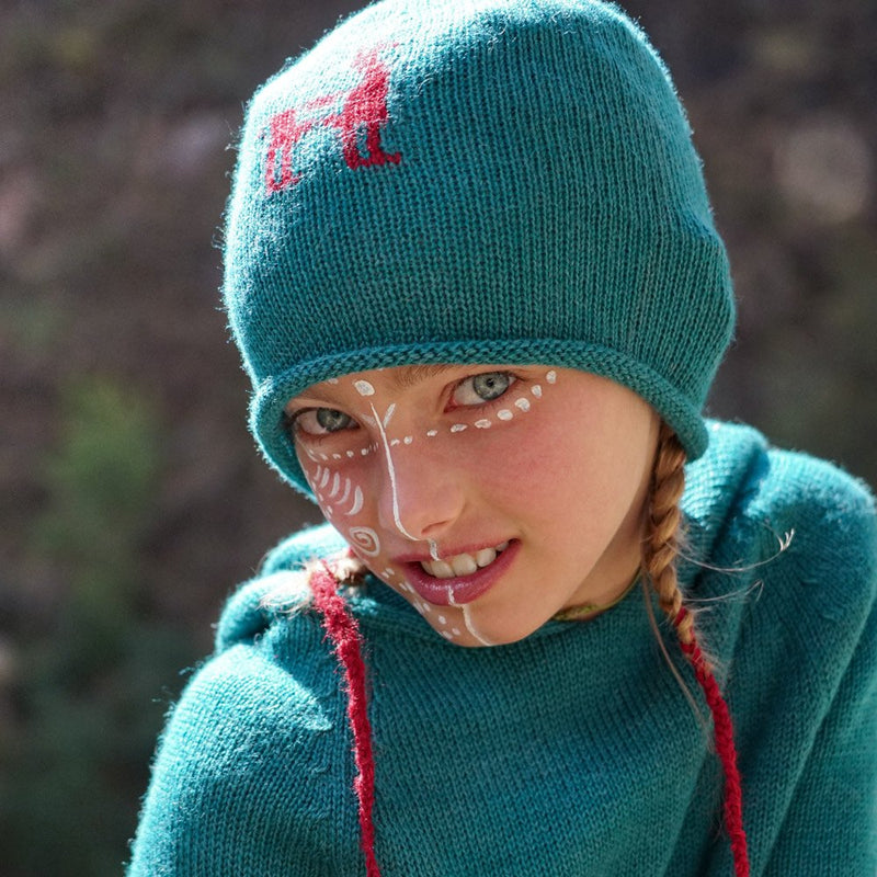 Girl with blue colored baby alpaca wool beanie