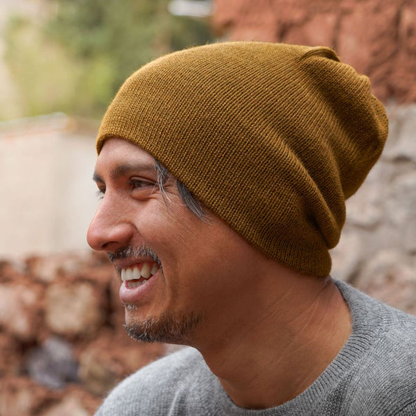 Man wearing brown colored baby alpaca wool beanie