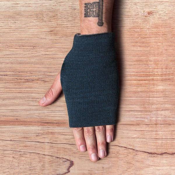 Hand with inside out gloves made of alpaca wool in the color blue