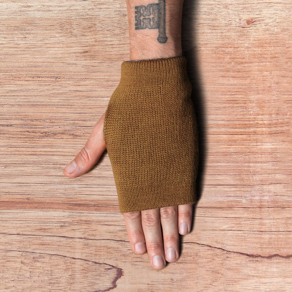 Hand with inside out gloves made of alpaca wool in the color brown
