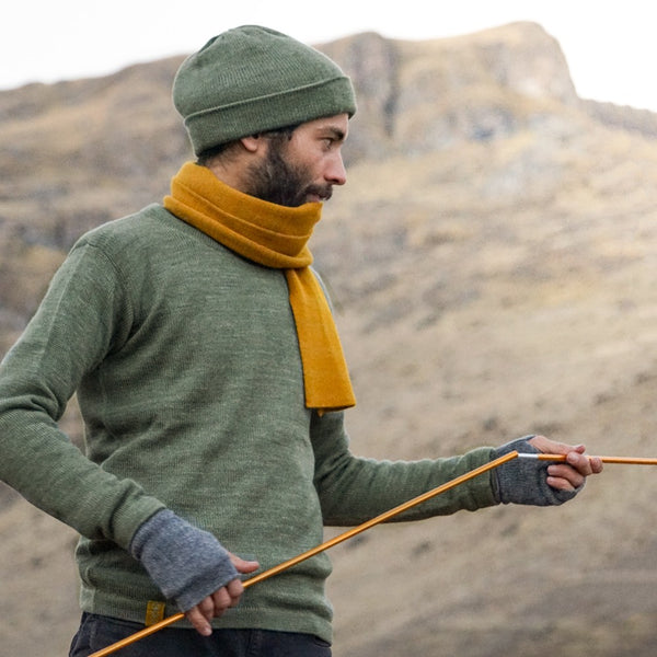 Man wearing baby alpaca clothes green and mustard