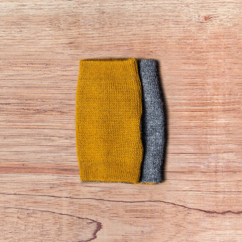 Inside out gloves made of alpaca wool in the color mustard and grey