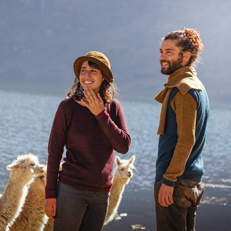 Couple with baby alpaca wool clothes in different colors