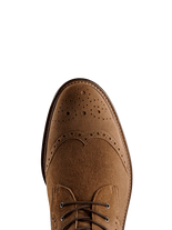 Balla in tan suede has beautiful brogue detailing over its round toe.
