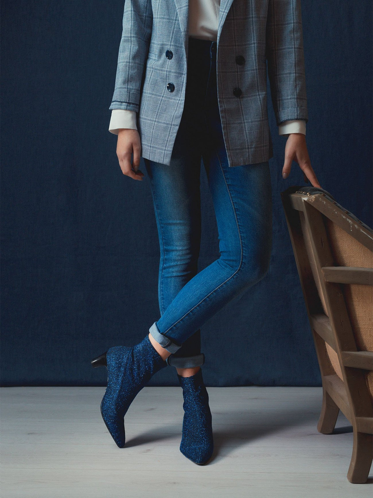 The blue sparkly boot has a fashionable sleek statement  silhouette.