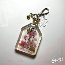 "Load image into Gallery viewer, Sakura ""Flying Safety"" Liquid Shaker Omamori"