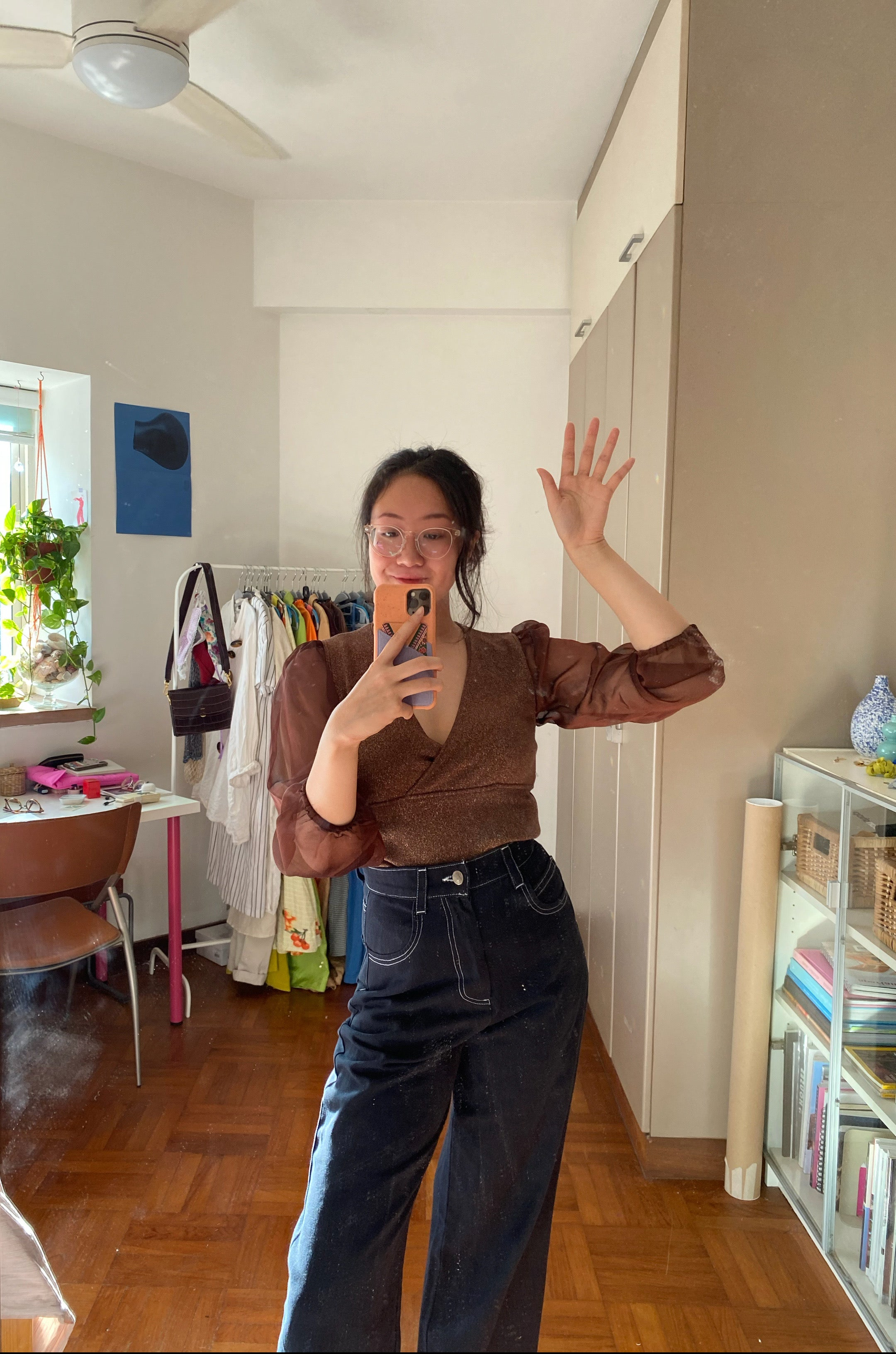 Weiqi Yap in thrifted brown glittery top and high-waisted denim from Lucy and Yak