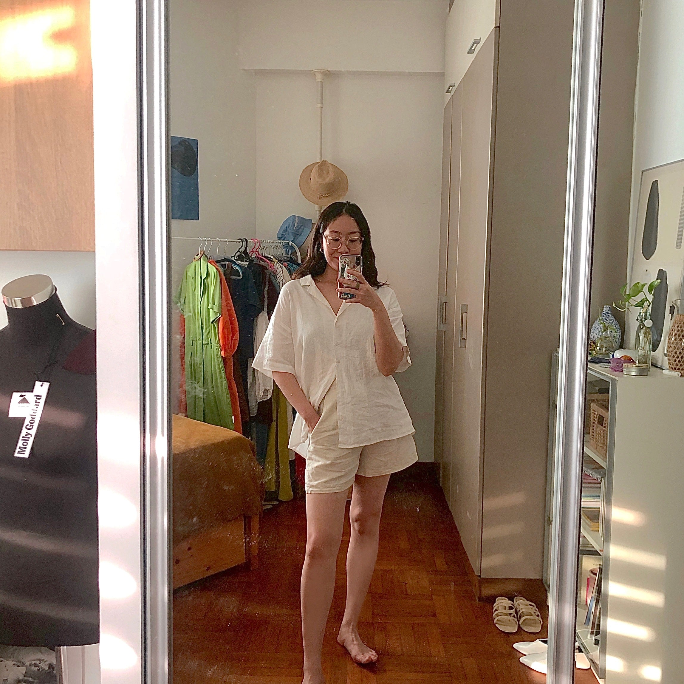 Weiqi Yap in white oversized shirt and cream linen shorts from The Fashion Pulpit