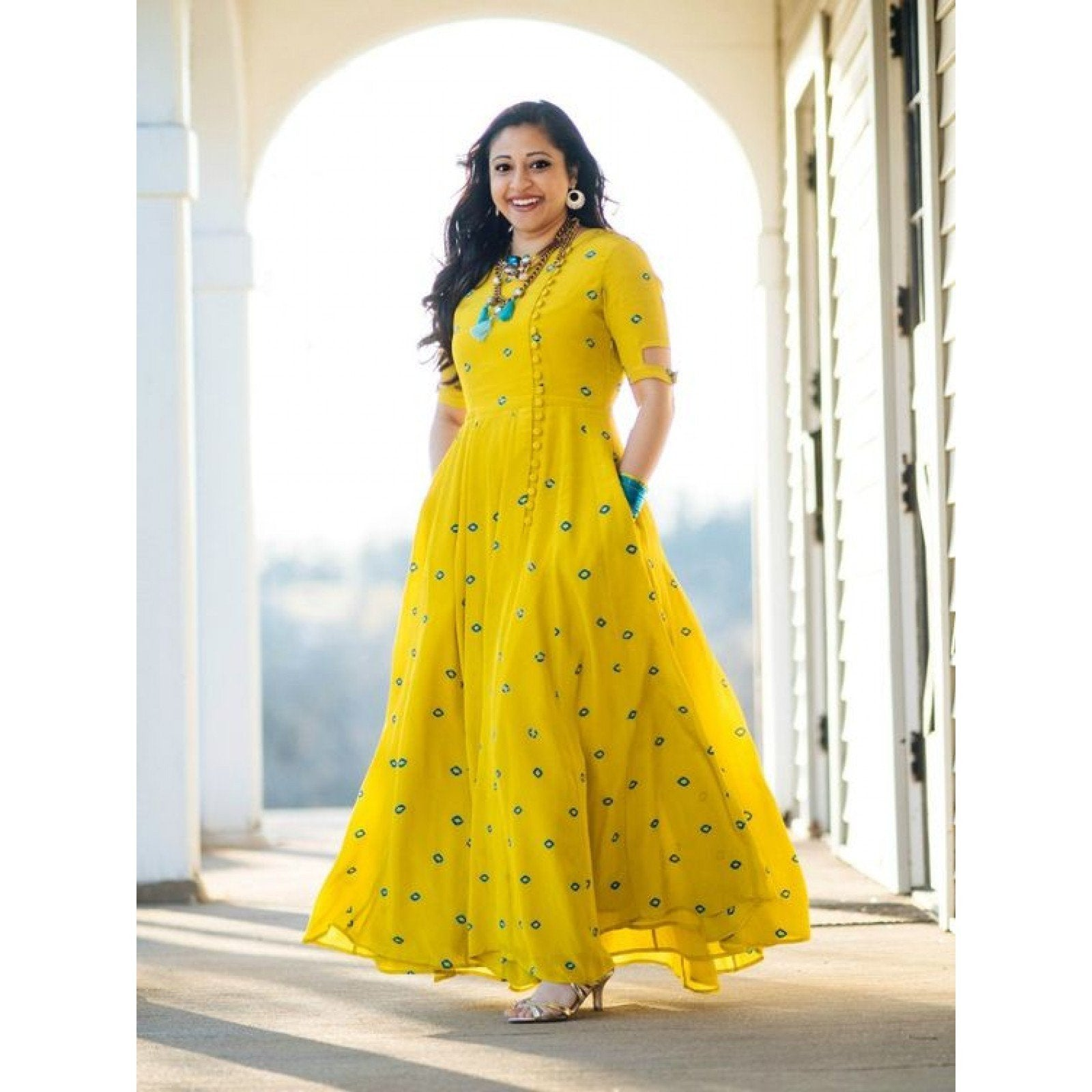 Impressive Yellow Colored Georgette Embroidered Designer Kurtis