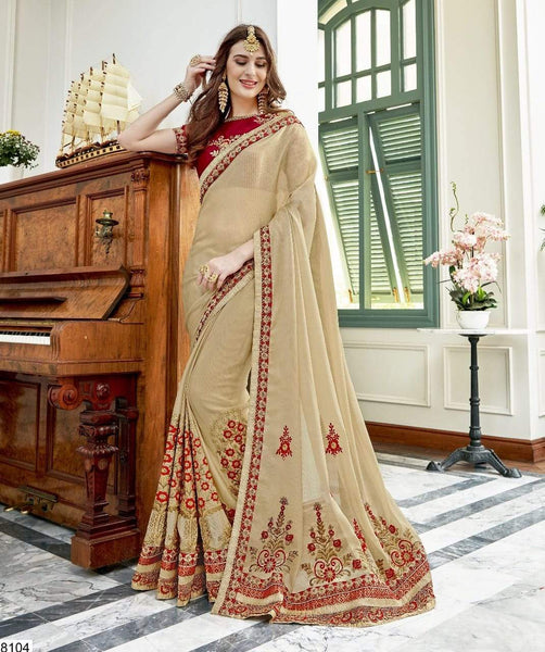 Engrossing Cream Colored Silk Embroidered Designer Saree